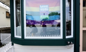 Josette and Kristen hung a pride flag in their window.